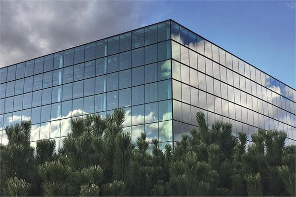 Glass-window building under the sun